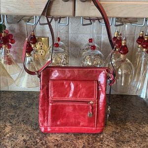 Lovely soft red genuine leather cross body purse.
